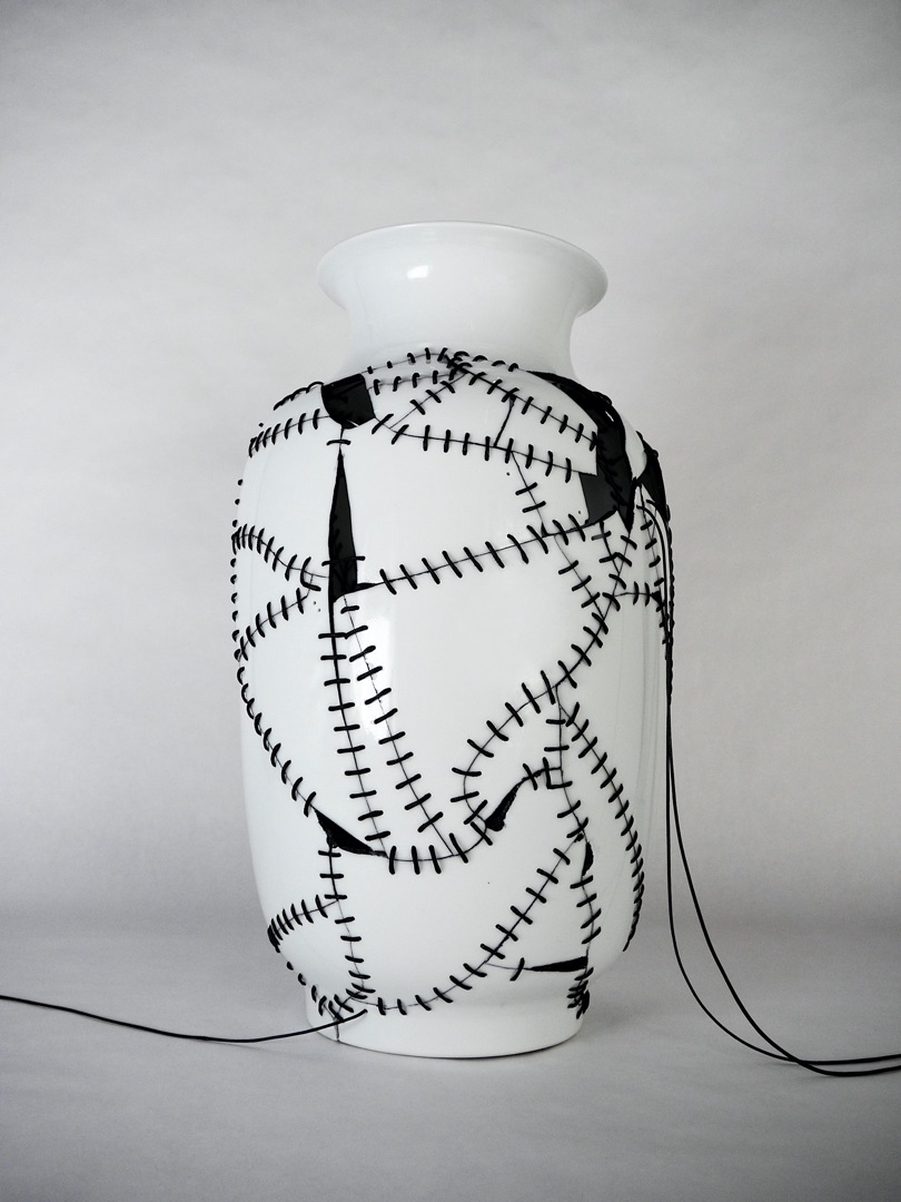 Frank Lee, Heirlooms, 2019. Reconstructed porcelain vase with permanent inked glue and synthetic cord. Height 43 cm, max diameter 76 cm, max cord drop 130 cm.
